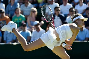 Eugenie Bouchard returns the ball during her first-round match against Ying-Ying Duan at Wimbledon in London, June 30, 2015. (REUTERS/Toby Melville)