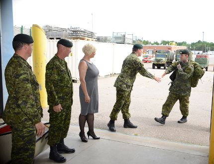 Ryan Paulsen / Daily Observer Chief Warrant Officer Marty Walhin, Regimental Sergeant Major (RSM) for 4 Canadian Division Support Group Op Services, left, Chief Warrant Officer Bill Fudge, RSM for 3rd Battalion, Royal Canadian Regiment, and Renfrew-Nipissing-Pembroke MP Cheryl Gallant wait their turn as 3 RCR commanding officer Lt.-Col. Will Gradyon welcomes Pvt. Casie Helie home on Tuesday afternoon after months in Eastern Europe with Operatio