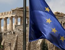 A European Union flag flutters before the temple of Parthenon at the Acropolis hill in Athens, Greece. (REUTERS)