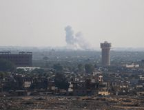 Smoke rises in Egypt's North Sinai as seen from the border of southern Gaza Strip with Egypt July 1, 2015. Islamic State militants launched a wide-scale coordinated assault on several military checkpoints in Egypt's North Sinai on Wednesday. REUTERS/Ibraheem Abu Mustafa