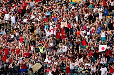 Soccer fans do the wave during the Japan and England FIFA Women's World Cup Canada 2015 game at Commonwealth Stadium, in Edmonton Alta. on Wednesday July 1, 2015. David Bloom/Edmonton Sun/Postmedia Network