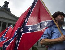 Pro-confederate flag demonstrator Jim Horky stands outside the South Carolina State House in Columbia, South Carolina, June 27, 2015. AFP PHOTO/JIM WATSON