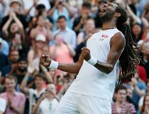 Dustin Brown of Germany celebrates after winning his match against Rafael Nadal of Spain at the Wimbledon Tennis Championships in London, July 2, 2015.           REUTERS/Stefan Wermuth