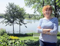 Prospect Street resident Maureen Russell would like to see Silver Lake in Port Dover stay as it is now that someone has slipped in and replaced the stop logs in Misner Dam. (MONTE SONNENBERG Simcoe Reformer)