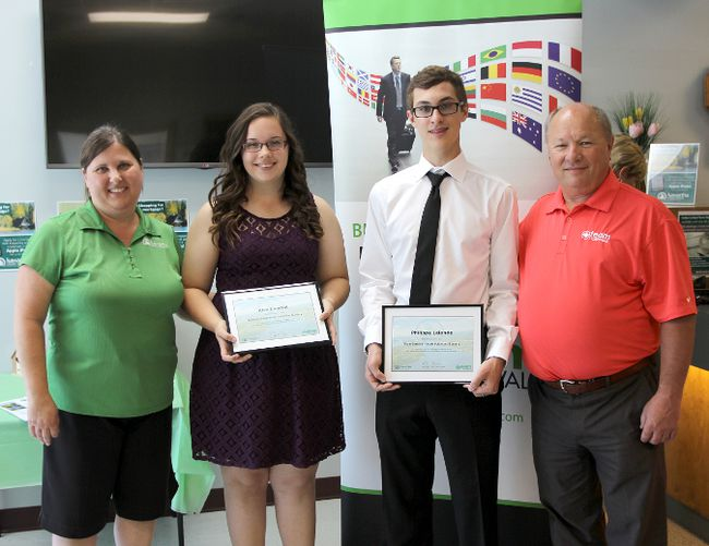 <p>Team Cornwall handed out bursaries recognizing community commitment to several local high school students on Friday, June 26, 2015.Pictured above (from left) bursary winners Kiran Hashmi, Kisa Lanctot and Phillipe Lalonde with Team Cornwall member Peter Gault. Handout/Cornwall Standard-Freeholder/Postmedia Network