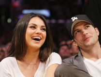 "Ashton Kutcher and Mila Kunis (<A HREF=""http://www.wenn.com"" TARGET=""newwindow"">WENN.COM</a>)"