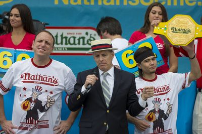 Matt Stonie (R) is crowned winner of the annual Fourth of July 2015 Nathan's Famous Hot Dog Eating Contest in Brooklyn, New York July 4, 2015. Stonie defeated 8 time champion Joey Chestnut 62-60, according to local media. REUTERS/Andrew Kelly