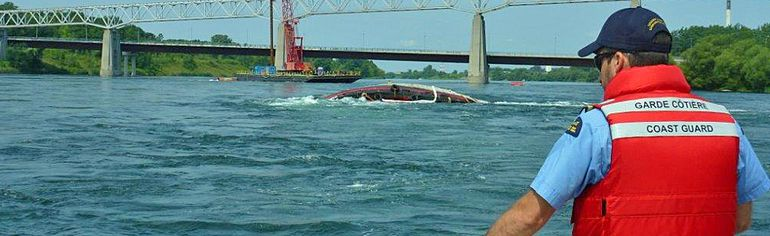 Salvage crews will begin lightering operations on Tuesday on the two tugs that capsized on the St. Lawrence River during the bridge demolition. Lightering is the process of removing oil or other hazardous chemicals from a compromised vessel. Handout/Cornwall Standard-Freeholder/Postmedia Network