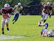 Damon Fair runs 68 yards for a touchdown for the Limestone District Grenadiers in the first half against the Metro Toronto Wildcats in Ontario Varsity Football League varsity division play at Loyalist Collegiate and Vocational Institute on Saturday. (Kendra Pierroz/For The Whig-Standard)