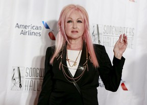 Singer Cyndi Lauper poses on the red carpet before the Songwriters Hall of Fame ceremony in New York, June 18, 2015.  REUTERS/Shannon Stapleton