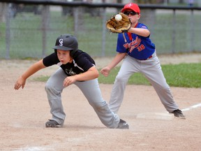 Mitchell Mosquito third baseman Charlie Wood grabs a relay from catcher Tanner Meinen during this rundown against Goderich during action from the Mitchell tournament this past Saturday, July 4. ANDY BADER/MITCHELL ADVOCATE