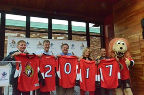 (From left) Team president Cyril Leeder, Mayor Jim Watson, Coun. Jean Cloutier, Brittany Forsyth, Guy Laflamme and Spartacat at Sens House in the Byward Market after the team made a major donation to the Ottawa 2017 campaign on Monday, July 7, 2015. SAM COOLEY/Ottawa Sun