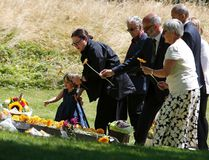 Gill Hicks (2nd R), a survivor of the July 7, 2005 London bombings, lays a flower as she attends a memorial event with her daughter Amelie to victims of the July 7, 2005 London bombings, at the memorial in Hyde Park, central London, Britain July 7, 2015. REUTERS/Peter Nicholls