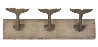 Subtle and rustic, this wall hook features three finback iron hooks, perfect for hanging towels, swimsuits or clothes while you shower.  $26.00   Urban Barn
