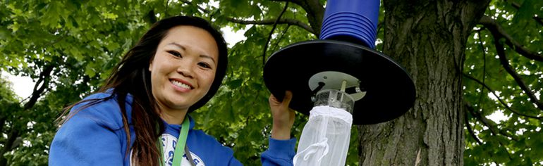 Villy Phraxayavong, public health inspector student, displays a standard mosquito trap used in Chatham-Kent through the summer to test for West Nile infected mosquitos. Photo taken  in Chatham, Ont. on Tuesday July 7, 2015. (Diana Martin/Chatham Daily News/Postmedia Network)