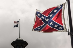 The Confederate battle flag flies at the South Carolina state house grounds July 8, 2015 in Columbia, South Carolina. South Carolina lawmakers will continue the debate today on whether to remove the flag from the capitol grounds. (Sean Rayford/AFP)