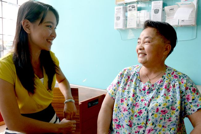 Simin Sun, left, a coordinator at the Downtown Eastside Neighbourhood House, speaks with Yolanda Li, a volunteer.