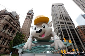 Pachi, mascot for the Pan Am Games, greets visitors at a bus stop in downtown Toronto Thursday. The city and region will hold the Games starting with today?s opening ceremony. (Julio Cortez / The Associated Press)