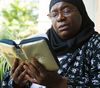 Michelle Walrond reads the Quran at her Ottawa home. She testified before the Senate committee on National Security.  Friday July 10, 2015.  Errol McGihon/Ottawa Sun
