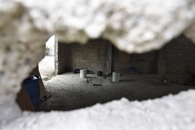 "Picture of the alleged end of the tunnel through which Mexican drug lord Joaquin ""El Chapo"" Guzman could have escaped from the Altiplano prison, at a house in Almoloya de Juarez, Mexico, on July 12, 2015. (AFP PHOTO/YURI CORTEZ)"