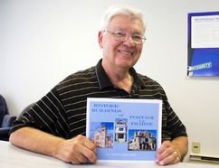 Local artist and photographer John Nielsen poses with his recently released book on historic buildings in Portage la Prairie, Historic Buildings of Portage la Prairie, at The Graphic office on July 8. (Svjetlana Mlinarevic/The Graphic/Postmedia Network)