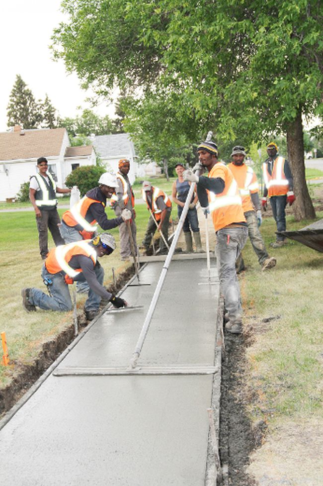 The Contour Concrete crew and Tri-S Concrete were busy smoothing out a newly-laid sidewalk on Monday, July 6, 2015 in Fairview, Alta.: Leroy Campbell, Andrew Morris, Anthony Hamilton, Dameion Hamilton, Gary Wright, Floyd Harris, Roger Hoben, Roy Moore and Mike Watchorn.