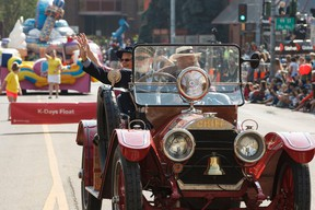 A classic fire engine is seen during the K-Days Parade in downtown Edmonton, Alta., on Friday, July 18, 2014. (Ian Kucerak/Edmonton Sun File Photo)