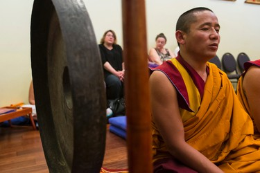 Monks from Namgyal Monastery in India conduct a ceremony of consecration at Gaden Samten's Alberta Centre for Peace and Meditation in Edmonton, Alta., on Thursday July 16, 2015. The elaborate rite transforms the statues of the centre into actual Buddhas. Abbott Thrumthog Rinpoche lead the rite. Ian Kucerak/Edmonton Sun/Postmedia Network
