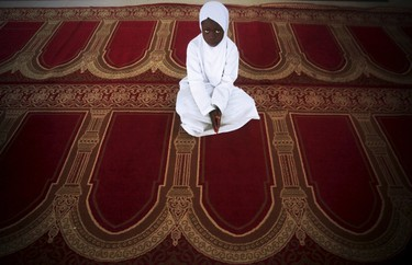 A girl looks on during Eid al-Fitr, marking the end of the holy month of Ramadan, at a mosque in Adjame, in the Ivorian capital Abidjan, July 17, 2015. REUTERS/Thierry Gouegnon