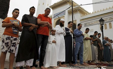 Worshippers attend morning prayers of Eid al-Fitr holiday, marking the end of the holy month of Ramadan, at al Biar mosque in Algiers, Algeria, July 17, 2015. REUTERS/Ramzi Boudina
