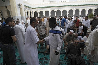 Worshippers congratulate each other after morning prayers of Eid al-Fitr holiday, marking the end of the holy month of Ramadan, at al Biar mosque in Algiers, Algeria July 17, 2015. REUTERS/Ramzi Boudina
