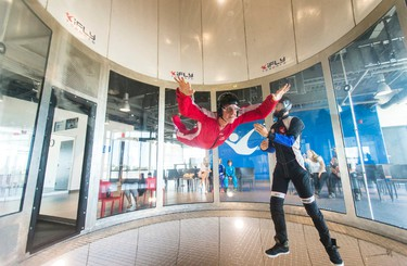 Toronto Sun reporter Kevin Connor enjoys the sensation of flying with the help of instructor Chris Andrews at iFLY Toronto indoor sky diving centre in Oakville, Ont.  on Thursday July 16, 2015. Ernest Doroszuk/Toronto Sun/Postmedia Network