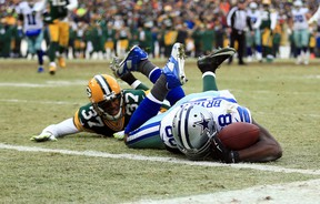 Cowboys wide receiver Dez Bryant (88) is unable to catch a pass against Packers cornerback Sam Shields (37) in the fourth quarter in the 2014 NFC Divisional playoff game at Lambeau Field in Green Bay, Wis., on Jan 11, 2015. (Andrew Weber/USA TODAY Sports)