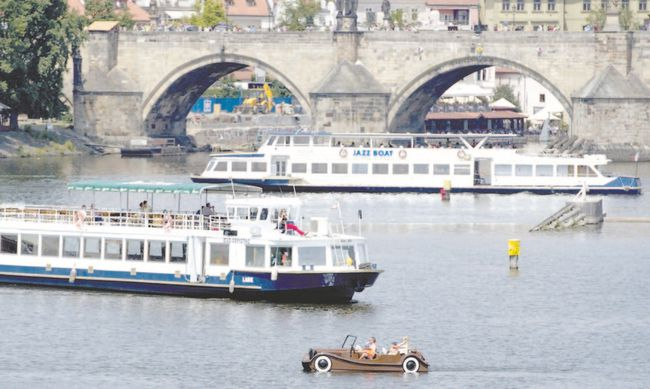 Tourists enjoy a sunny day as they use various boats to cruise the Vltava River in Prague, Czech Republic  in June. Glen Pearson says numerous river recovery projects in Europe are trying to restore rivers after, in many cases, millennia of abuse. (JOE KLAMAR/AFP photo)