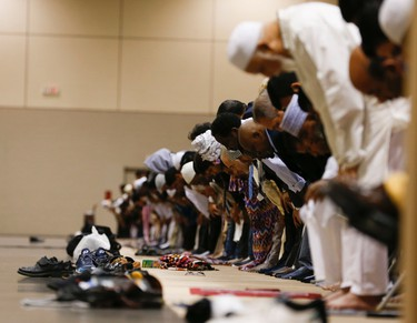 Toronto area Muslims participated in prayers at the Eid al-Fitr Festival at the the Metro Toronto Convention Centre on Friday July 17, 2015 . Jack Boland/Toronto Sun/Postmedia Network