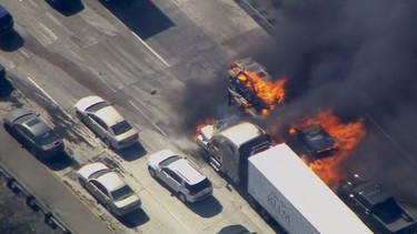 Cars are shown burning on the Interstate 15 freeway in the Cajon Pass, California in the frame grab from KNBC video July 17, 2015.  A brush fire burning in foothills north of Los Angeles overran a freeway in a mountain pass on Friday, torching several cars and trucks as drivers scrambled to safety.  REUTERS/NBCLA.COM/HANDOUT