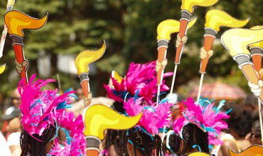 Young masqueraders  and revellers danced through the Malvern area of Scarborough yesterday to R&B, Soca, Calypso as part of the Junior Carnival parade  on Saturday July 18, 2015. Jack Boland/Toronto Sun/Postmedia Network