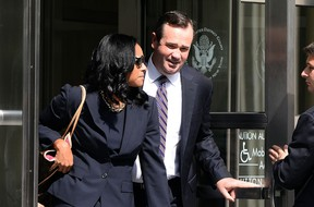 Former FIFA vice president Jeffrey Webb's lawyer Edward O'Callaghan (right) and Webb's wife Kendra Gamble-Webb leave the federal court house in Brooklyn borough of New York on July 18, 2015. (AFP PHOTO/JEWEL SAMAD)