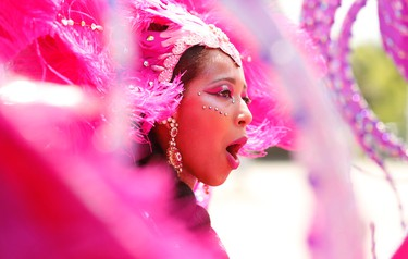Faith Hermelijm - part of the Louis Saldenah group as the Indian gal - danced through the Malvern area of Scarborough yesterday to R&B, Soca, Calypso as part of the Junior Carnival parade  on Saturday July 18, 2015. Jack Boland/Toronto Sun/Postmedia Network
