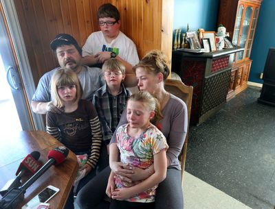 Eric Courtney, his wife Teenah Snowden and their kids sit in shock in their Gracefield Quebec home Friday Feb 27, 2015. The Courtney family lost two kids in a house fire Thursday night. Tony Caldwell/Ottawa Sun/QMI Agency