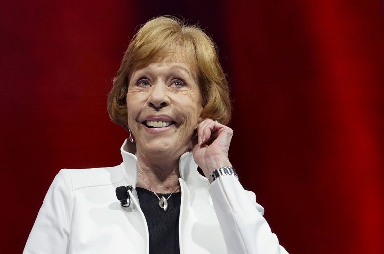 Actress Carol Burnett does her trademark ear tug at the annual meeting ...