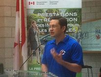 Pierre Poilievre's decision to wear a Conservative Party golf shirt during an announcement Monday, July 20, 2015 on child care benefits payments is being criticized by the opposition as an attempt to put a party brand on public money.THE CANADIAN PRESS/ HO/Andrew Pinsent, News 95.7 (CJNI Halifax)