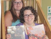Wetaskiwin Parent Link Centre's co-ordinator (front) Julia Karg-Magas and outreach worker Andrea Dyck display the books they are using to help moms talk to kids about racism.