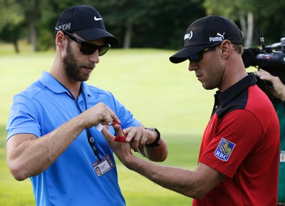 Canadian Graham DeLaet gets his left hand taped during first round action at the RBC Canadian Open at Glen Abbey Golf Course on Thursday July 23, 2015. Craig Robertson/Toronto Sun/Postmedia Network