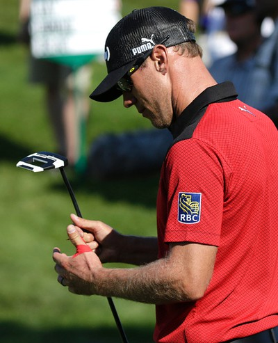 Canadian Graham DeLaet looks at his taped hand during first round action at the RBC Canadian Open at Glen Abbey Golf Course on Thursday July 23, 2015. Craig Robertson/Toronto Sun/Postmedia Network