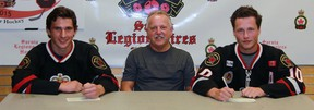 The Sarnia Legionnaires have signed two more players for the upcoming Greater Ontario Junior Hockey League season, including, from left, 17-year-old Corunna native Ethan DuPont and 19-year-old Brad Yowart from Guelph. Head coach Mark Davis, middle, is looking forward to what the new players will bring to his squad. (Terry Bridge/Sarnia Observer/Postmedia Network)
