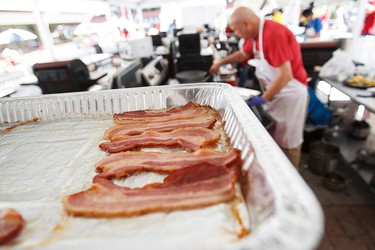 Neil Krog of Twisted Forks Catering competes in the sandwich finals during the Canadian Food Championships during Taste of Edmonton at Centennial Square in Edmonton, Alta., on Friday July 24, 2015. Ian Kucerak/Edmonton Sun/Postmedia Network
