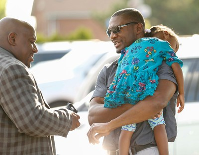 A pastor greets former Canadian boxer Troy Ross (R) - and uncle of the deceased - before entering a visitation that was held at Bernardo Funeral Home on Albion Road Friday July 24, 2015 for 14-year-old Lecent Ross, who was killed after a tragic shooting incident at a Jamestown Crescent townhouse in Rexdale on July 9. Jack Boland/Toronto Sun/Postmedia Network