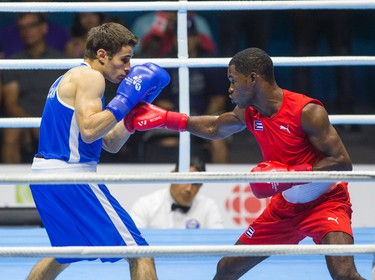 Canadian Arthur Biyarslanov (Blue) won gold over Yasnier Toledo of Cuba during Men's Boxing  Light Welter (64kg) Finals during Pan Am Games at Oshawa Sports Center in Oshawa, Ont. on Friday July 24, 2015. Ernest Doroszuk/Toronto Sun/Postmedia Network