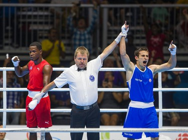Canadian Arthur Biyarslanov (Blue) celebrates as he hears the decision that he won gold over Yasnier Toledo of Cuba during Men�s Boxing  Light Welter (64kg) Finals during Pan Am Games at Oshawa Sports Center in Oshawa, Ont. on Friday July 24, 2015. Ernest Doroszuk/Toronto Sun/Postmedia Network
